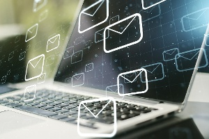 Troubleshooting Email Bounces - Laptop with bounced emails image - 2021